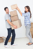 Woman giving boxes to her husband Royalty Free Stock Image