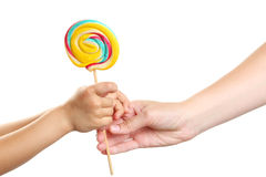 Woman giving candy to child Royalty Free Stock Photography