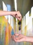Woman giving car key to man Stock Photos