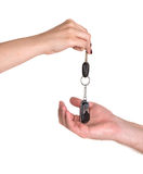 Woman giving car key to man Stock Images