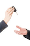 Woman giving car keys to the man Stock Photo