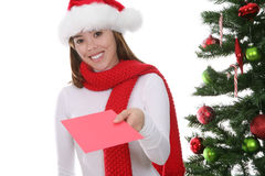 Woman Giving Christmas Card Stock Images