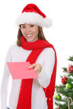 Woman giving Christmas card Stock Image