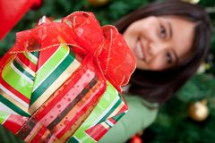Woman giving a Christmas gift Stock Photography