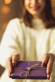 Woman giving christmas gift Royalty Free Stock Photography