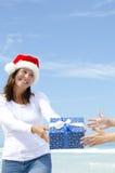 Woman giving Christmas Present outdoor Royalty Free Stock Photos