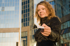 Woman giving credit card Royalty Free Stock Photos