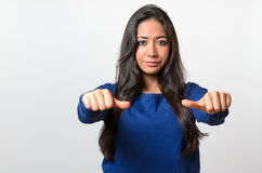 Woman giving an equal thumbs gesture Stock Photography