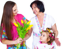Woman giving flowers Stock Image