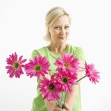 Woman giving flowers. royalty free stock images