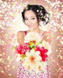 Woman giving flowers. Flower delivery Royalty Free Stock Photos