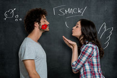 Woman Giving Flying Kiss To Man royalty free stock images