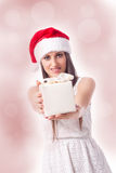 Woman is giving a gift Stock Image