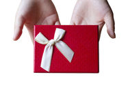 Woman giving gift. Royalty Free Stock Photography