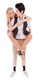 Woman giving her lesbian partner a piggy back ride Royalty Free Stock Photos