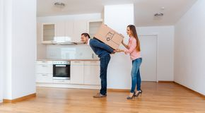 Woman giving her man a moving box stock photos