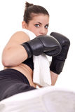 Woman giving high kick. Cute woman with boxing gloves giving  high kick Stock Photography