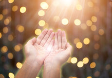 Woman giving or holding hands on celebration bokeh background. stock image