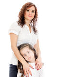 Woman giving a hug to her little daughter. Royalty Free Stock Photos