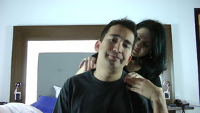 Woman giving husband a massage. Man with problems while his family are on the bed stock video