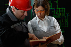 Woman is giving instructions to worker in power plant. Dispatcher is giving instructions to worker power distribution control center Royalty Free Stock Images