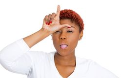 Woman giving loser sign on forehead Stock Photo