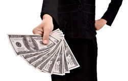 Woman giving a lot of money. Isolated on white background Royalty Free Stock Images