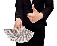 Woman giving a lot of money and shows thumbs up Royalty Free Stock Images