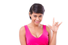 Woman giving love hand sign gesture Royalty Free Stock Photos