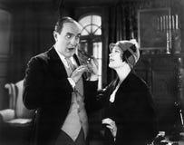 Woman giving a man a cigar Stock Photo