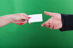 Woman giving man her business card Stock Photos