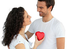 Woman giving man her heart Stock Photos