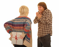 Woman giving man present Stock Image