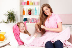 Woman giving medicine to child Royalty Free Stock Image