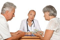 Woman giving money to a doctor Stock Photography