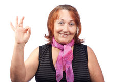 Woman giving OK hand sign Stock Photography