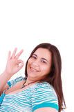 Woman giving ok hand sign Royalty Free Stock Photography