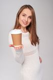 Woman giving paper cup stock image