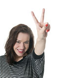Woman giving Peace sign. Laughing young woman showing victory-sign Stock Images