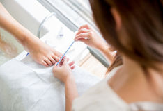 Woman giving a pedicure Royalty Free Stock Photography