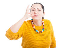 Woman giving a perfect gesture with hand Stock Image