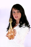Woman Giving Perfume Royalty Free Stock Photography