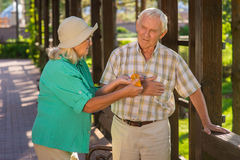 Woman giving pills to man. Royalty Free Stock Photo