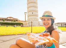 Woman giving pizza in front of tower of pisa Royalty Free Stock Photos