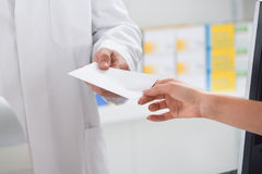 Woman Giving Prescription Paper To Pharmacist Stock Photos