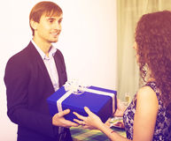 Woman Giving Present To Man Royalty Free Stock Photos
