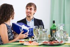 Woman giving present to man Stock Photos