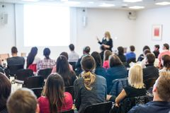 Woman giving presentation on business conference workshop. stock photography