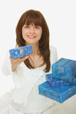 A woman giving presents Stock Photo