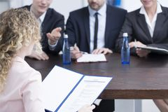 Woman giving references to recruiters. During a job interview in a company Stock Photography